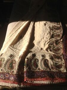 Cream saree with red and purple border, with blous