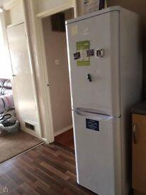 Fridge freezer, washing machine, coffee table, electrical heaters, book shelf, TV stand
