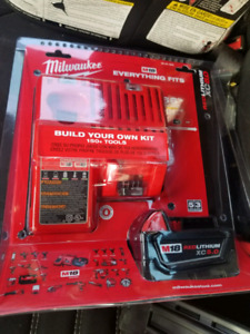 Kit m18 5 amp  et chargeur milwaukee