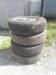 4 15's Michelin x-ice tires on rims - asking $450
