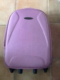 Light pink cabin case on wheels