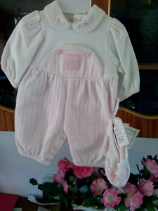 Brand new baby girl playsuit with cap.