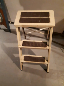 Three step metal stool 25 inches high