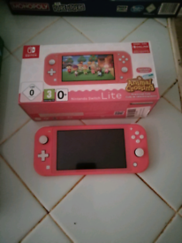 Nintendo switch lite with digital animal crossing in coral