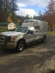 2011 Ford F-350 crew cab with spacekap