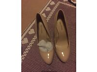 Call it Spring nude heels shoes