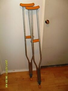 Like-New, adjustible crutches, with fold-up and down ice picks.
