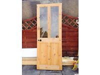 Wooden door with glass window