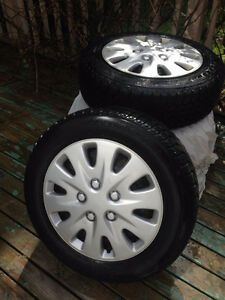 16 INCH UNIROYAL WINTER TIRES AND RIMS.  OFF A HONDA ACCORD