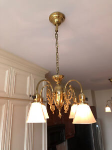 Pair of beautiful, vintage brass chandeliers with glass shades