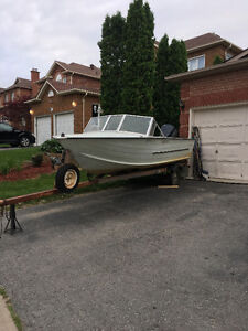 Boat,motor, and trailer