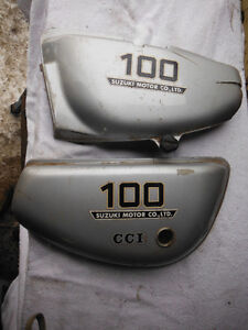 Suzuki 100 Pair of SIDE COVERS with some damage,