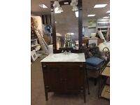 Free standing sink and bevelled mirror with marbled top