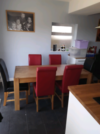 Used Oak dining table with 6 leather chairs.