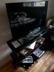42 inch very slim RCA flat screen tv  and solid glass stand