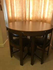 Round space saver dining table