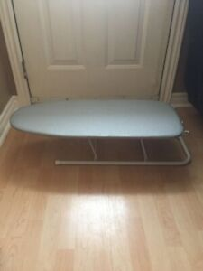 Small ironing board with iron