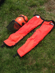 chain saw chaps and safety helmet