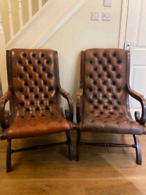 Stunning vintage mahogany and leather Chesterfield slipper chairs