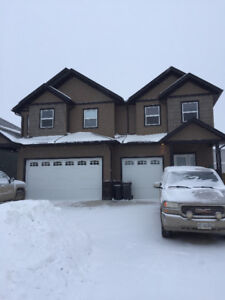 3 yr old duplex in new northern subdivision by walking trails .
