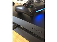 500GB PlayStation 4 (Jet Black) - includes 6 games