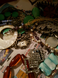Unsorted costume jewelry and watches.