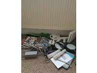 Wii bundle with a load of accessories and games aswell as a Wii fit board