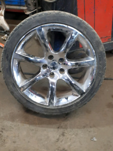 Aftermarket 18 inch chrome rim and tires