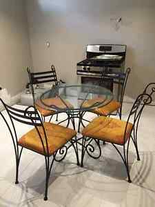Rod iron and glass table with chairs