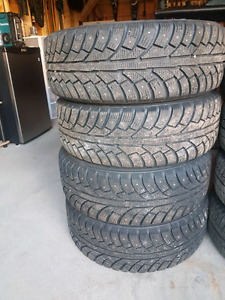 4 Like New Studded Winter Tires On Rims