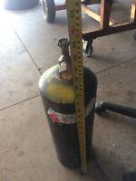 "Acetylene tank. 2"" tall full of gas"