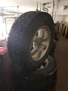 Snow Trires and Nissan Factory Rims