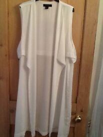 Cream sleeveless jacket size 18