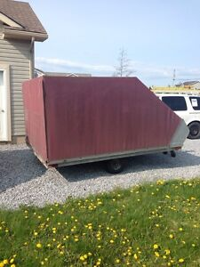 2 snowmobiles and covered trailer