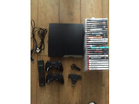 PlayStation 3 120gb slimline with 25 games and accessories