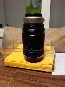 Olympus 70-300 telephoto /with m4/3 adapter 150$