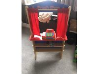 Children's shop/puppet show with full and basket