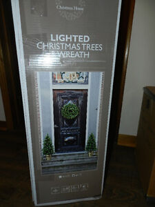 Lighted trees and Wreath and door /wall display