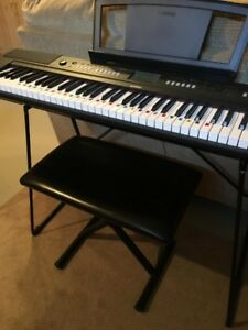 Yamaha Keyboard with bench and music books