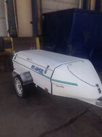 Glider enclosed utility trailer