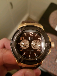 Brown Guess watch (The Rigger)
