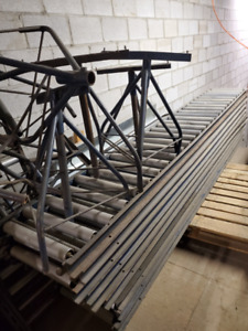 "Steel Gravity Conveyors 10'x18""x3""  165' in total with stands."