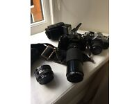 Canon A1 and Canon AE1 cameras with assorted lenses