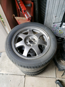 "Toyota 16"" alloy rims and tires"