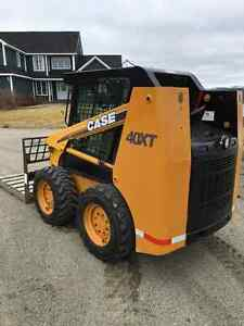 Case 40XT skid steer loader with attachments