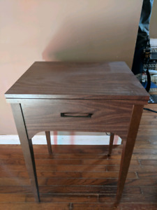 Antique sewing machine with table