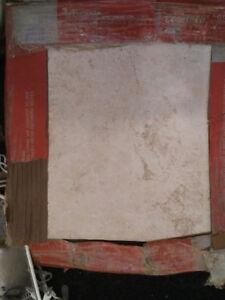 Ceramic tiles.  12X12. 2 boxes: 24 tiles.  $20 for both boxes.