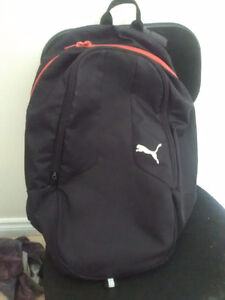 PUMA polyester black and red casual backpack style no. 071098