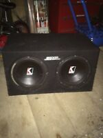 "Two 10"" kicker subs in enclosed box"