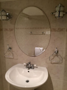 Vanity bathroom with side lamps